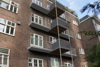Vernieuwen en vergroten van balkons Apollolaan Amsterdam